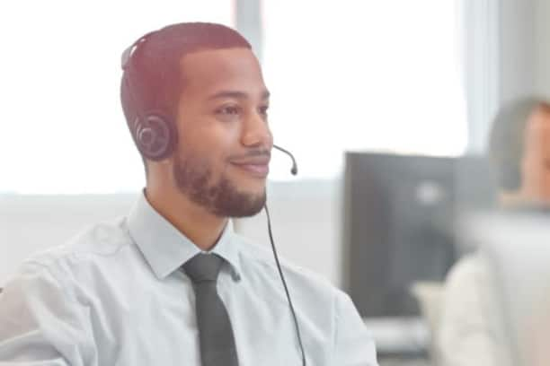 Customer service man wearing headphones